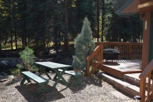 Picnic table outside cabin