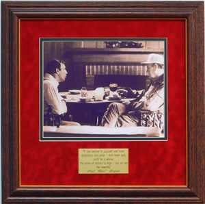 "WHAT A GREAT PHOTO PRINT OF TWO OF THE FINEST COACHES TO EVER COACH IN THE SEC. ALABAMA AND AUBURN FANS ALIKE WILL LOVE THIS COLLECTORS ITEM. This framed photo print shows Paul W. ""Bear"" Bryant, the world famous coach of the Alabama Crimson Tide and his one time protege and assistant coach, Pat Dye. Pat Dye went on to coach the Auburn Tigers, Alabama's cross state rivals. These two are at an undisclosed hunting cabin probably discussing football over drinks!! This piece is Professionally Framed in a 1 1/2"" Dark Cherry with gold lip moulding that measures approximately 16"" X 16"". It is double matted in your choice of two options: A tan linen outer matte with a dark maroon inner matte, or a Crimson suede outer matte and black inner matte. Both with glass and backing. There is also an engraved bronzed plate of one of The Bear's most famous quotes inset in the mattes. The quote reads: ""If you believe in yourself and have dedication and pride-and never quit, you'll be a winner. The price of victory is high-but so are the rewards."" Paul ""Bear"" Bryant Don't pass this one up, it's in mint condition."